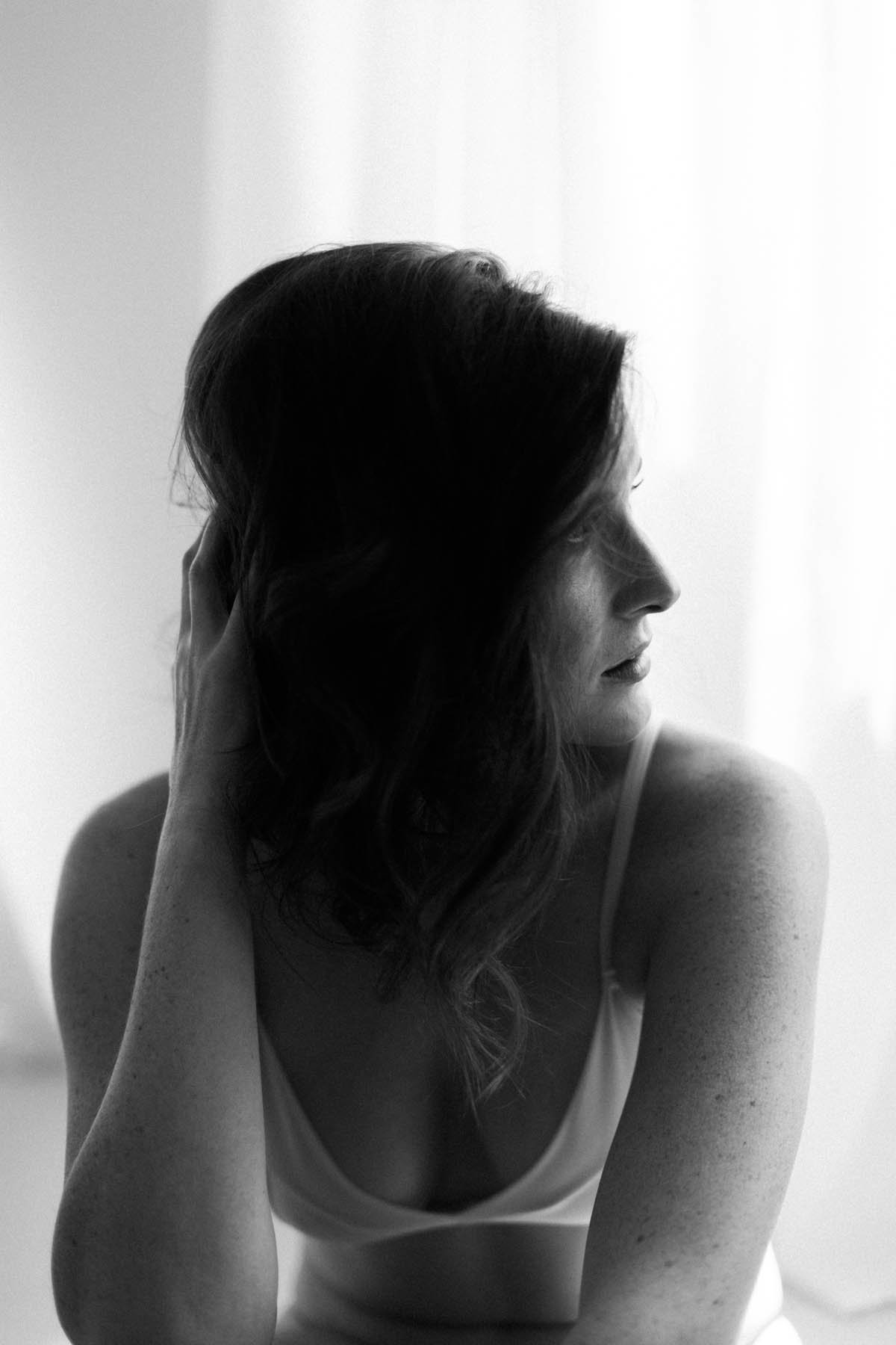 black and white image of a woman during boudoir session