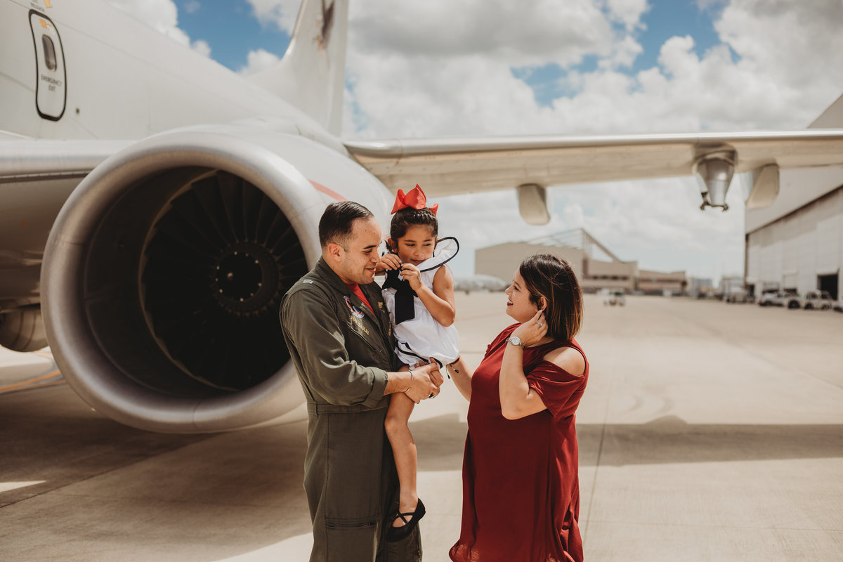 Okinawa Family Photography,  father military home coming with plane in the background
