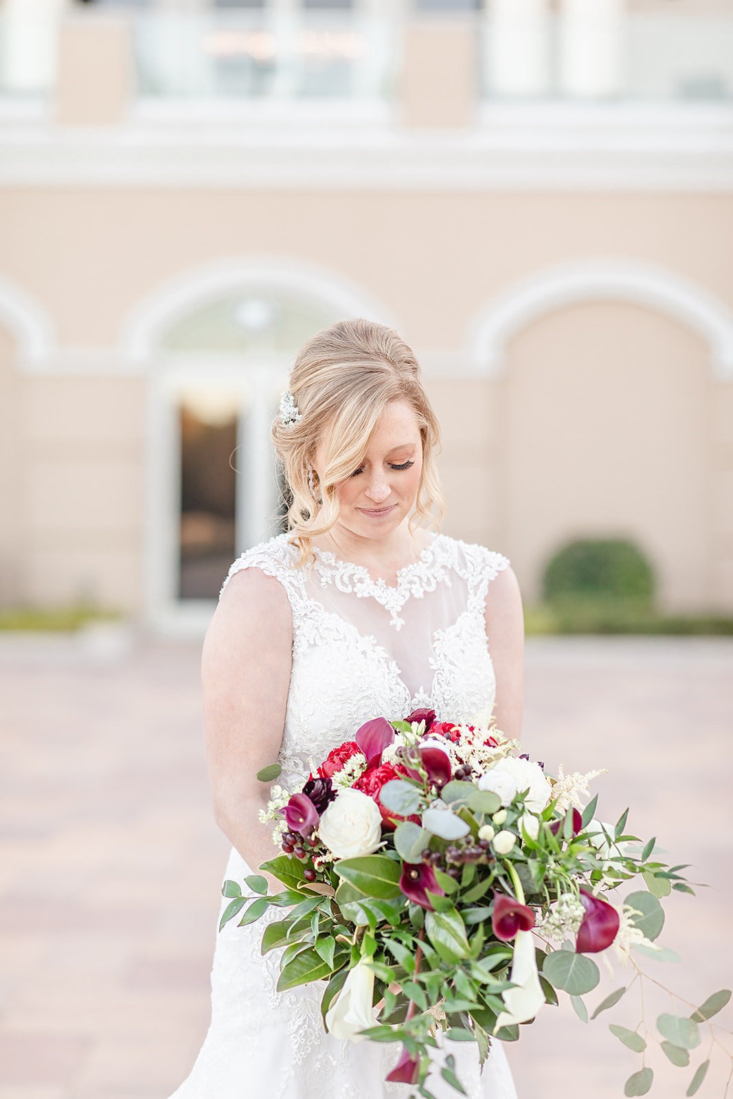 Red burgundy white and greenery bridal bouquet and happy bride