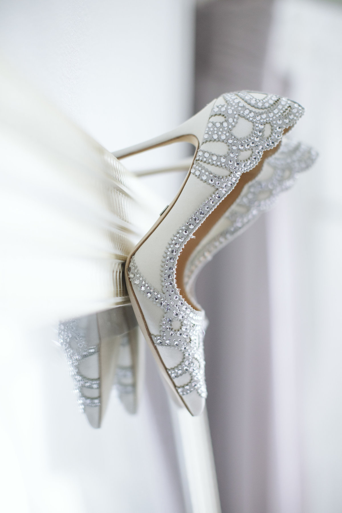 wedding shoes resting on mirror