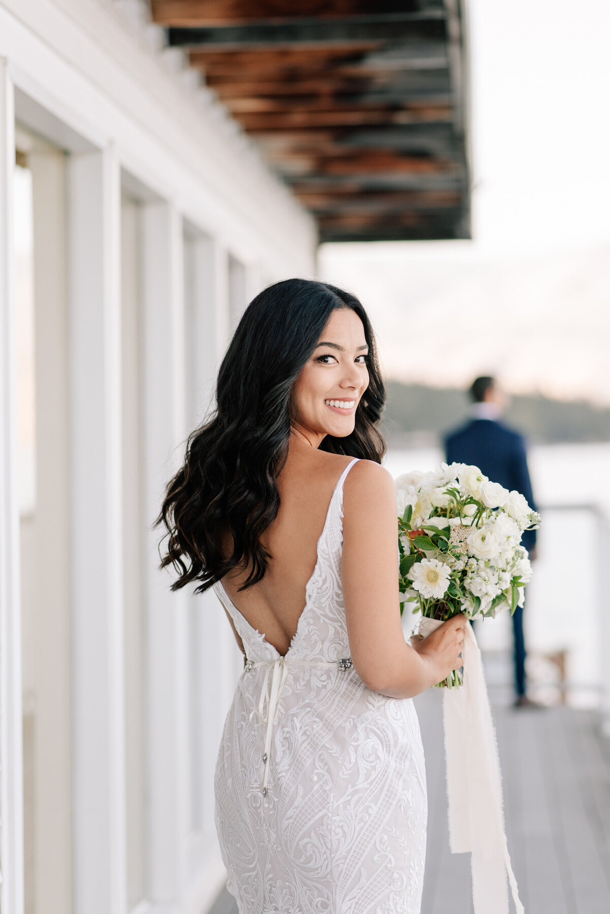 Bride looks back and smiles before the first look at a Lake Chelan Airbnb