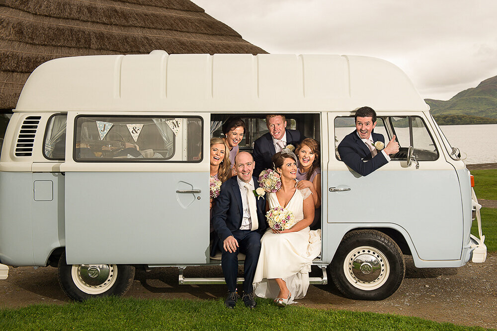 bridal party sitting in the back of a vintage Volkswagen camper van at the Europe Hotel, Killarney