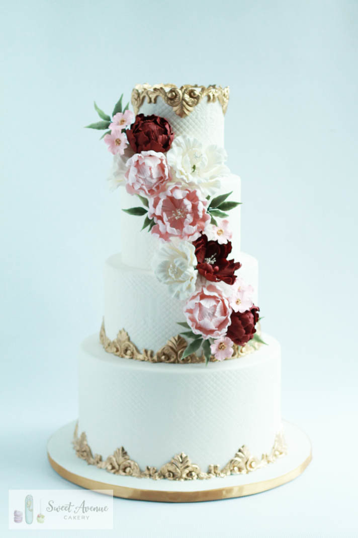 regal gold and white wedding cake with sugar flower cascade and gilded trims, Hamilton ON wedding cakes