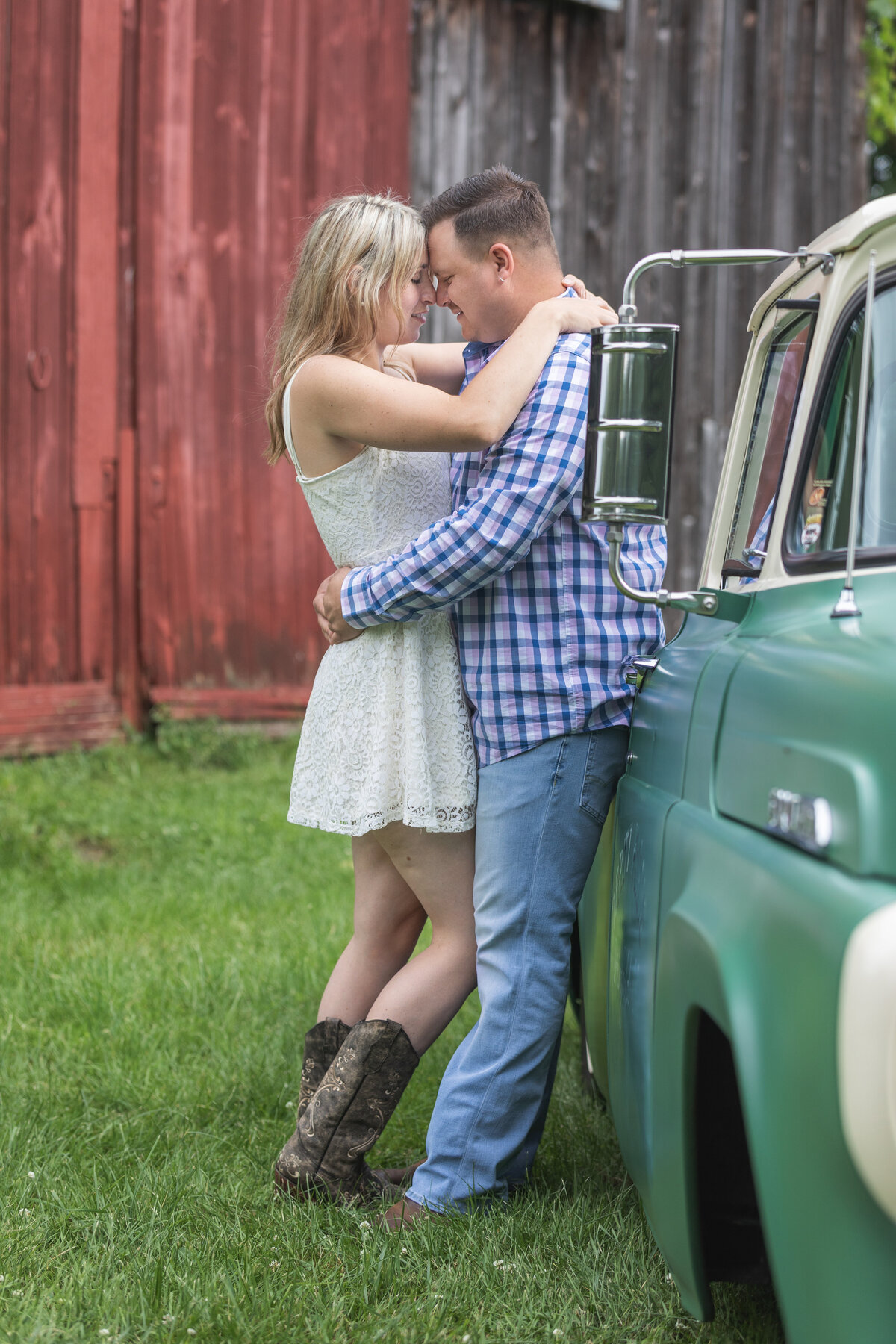 engaged couple standing by truck farmhouse New jersey