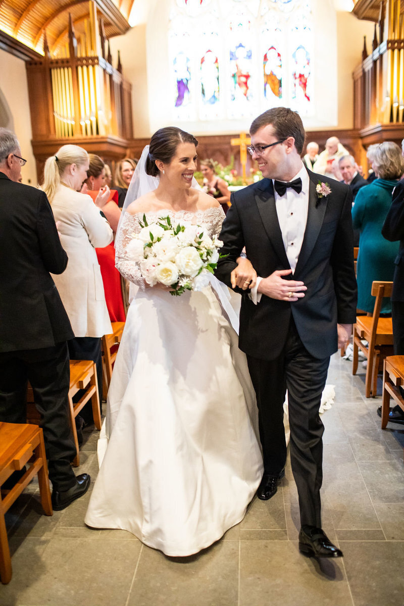 just-married-walking-down-aisle-dahlgren-chapel
