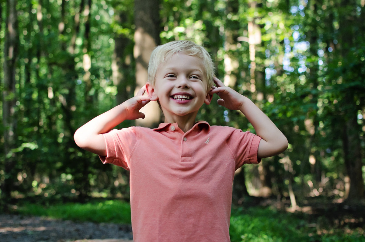 Portrait of a laughing child during a lifestyle session at Nottoway Park in Northern Virginia taken by Sarah Alice Photography