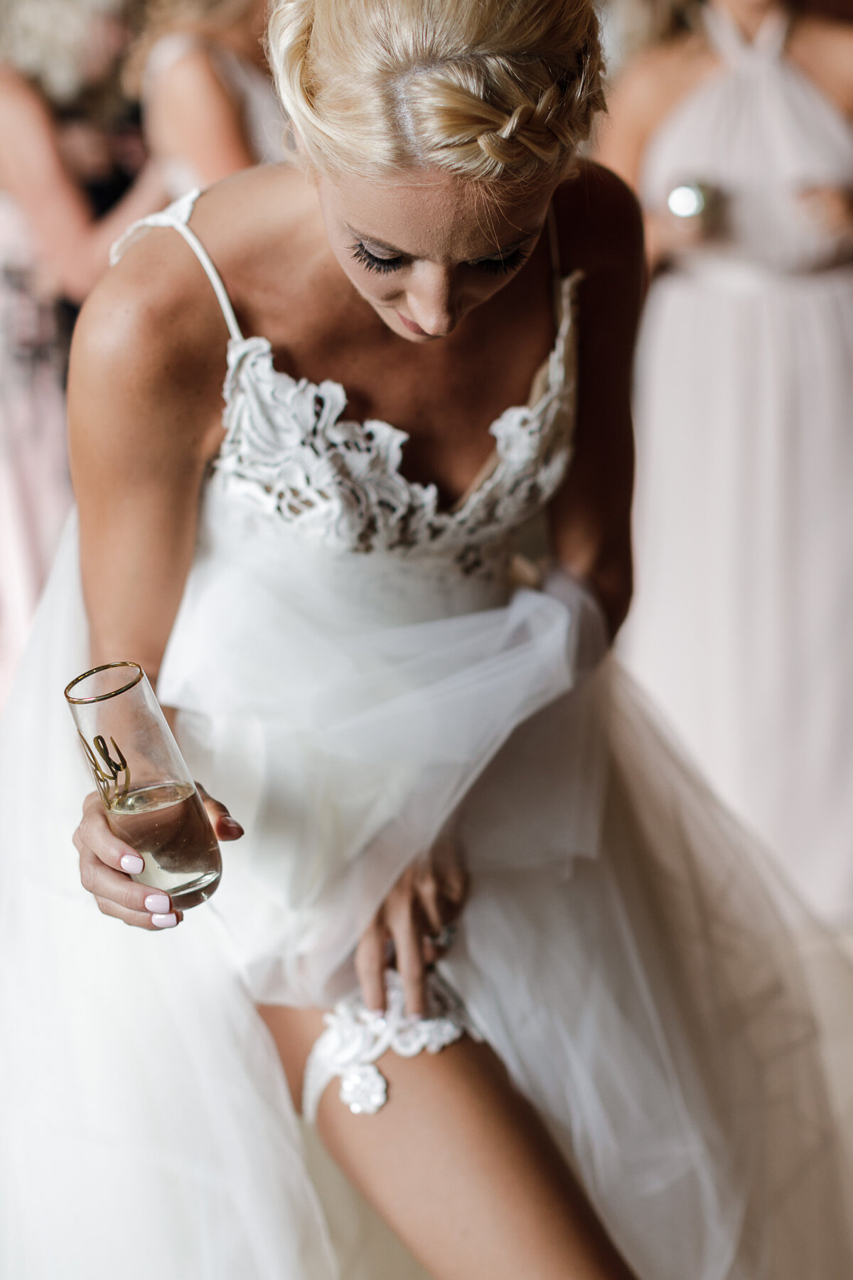 bride checks her garter before her ceremony at the Addison in Boca Raton