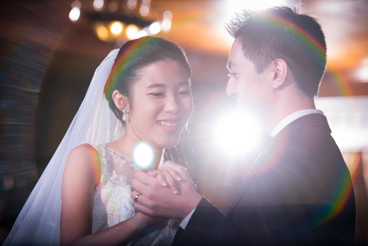 first dance with rainbow lens flare