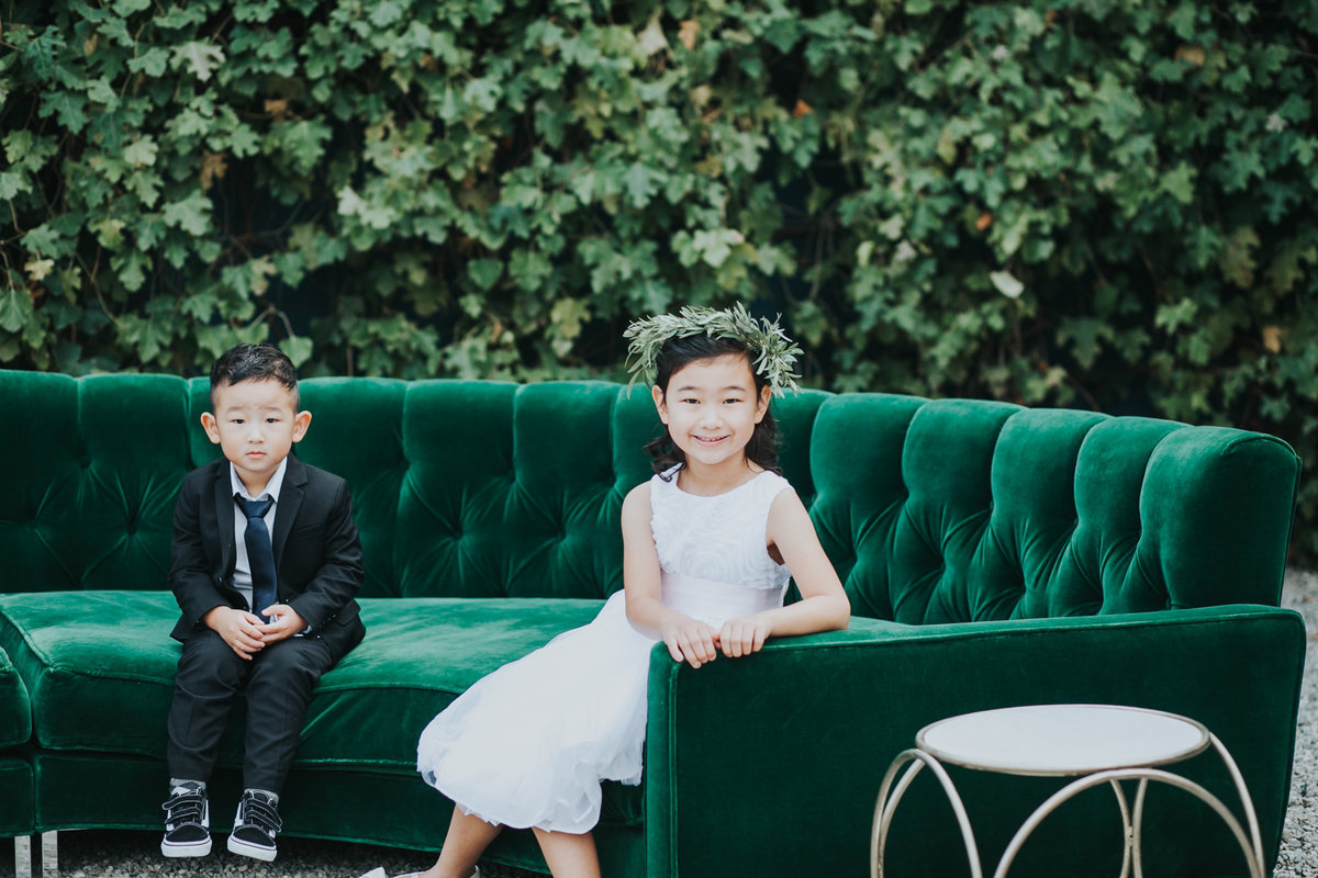 Ring bearer and flower girl with floral crown at The Fig House wedding