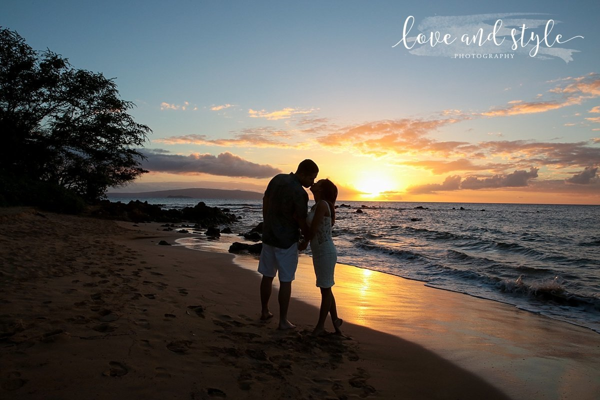 Sarasota-Bradenton Engagement Photography of couple kissing  silhouetted with the sunset