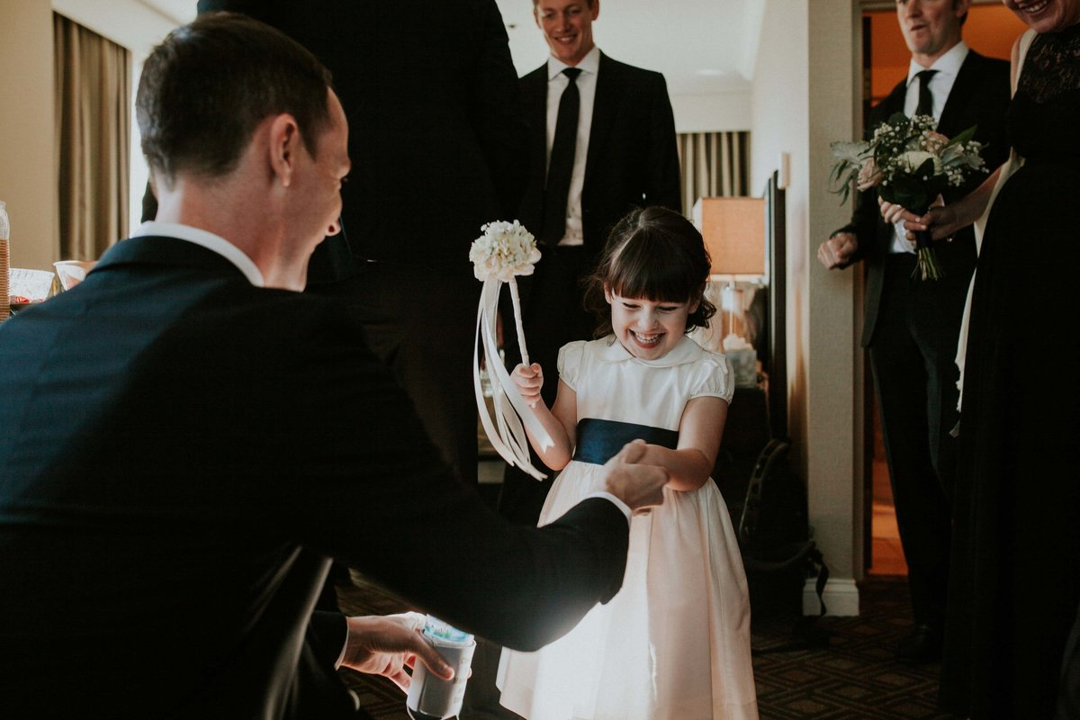 Groom hold flower girls hand at Scottish Rite wedding