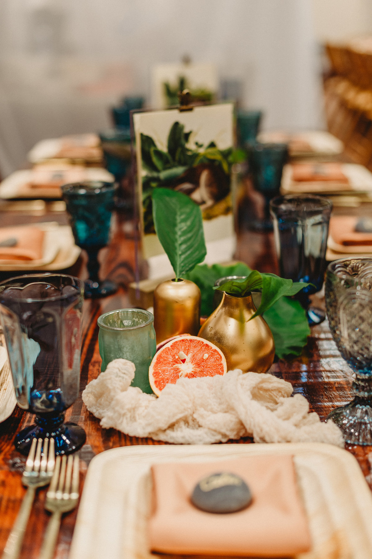 Tropical design with fruits and gold silverware and blue water goblets