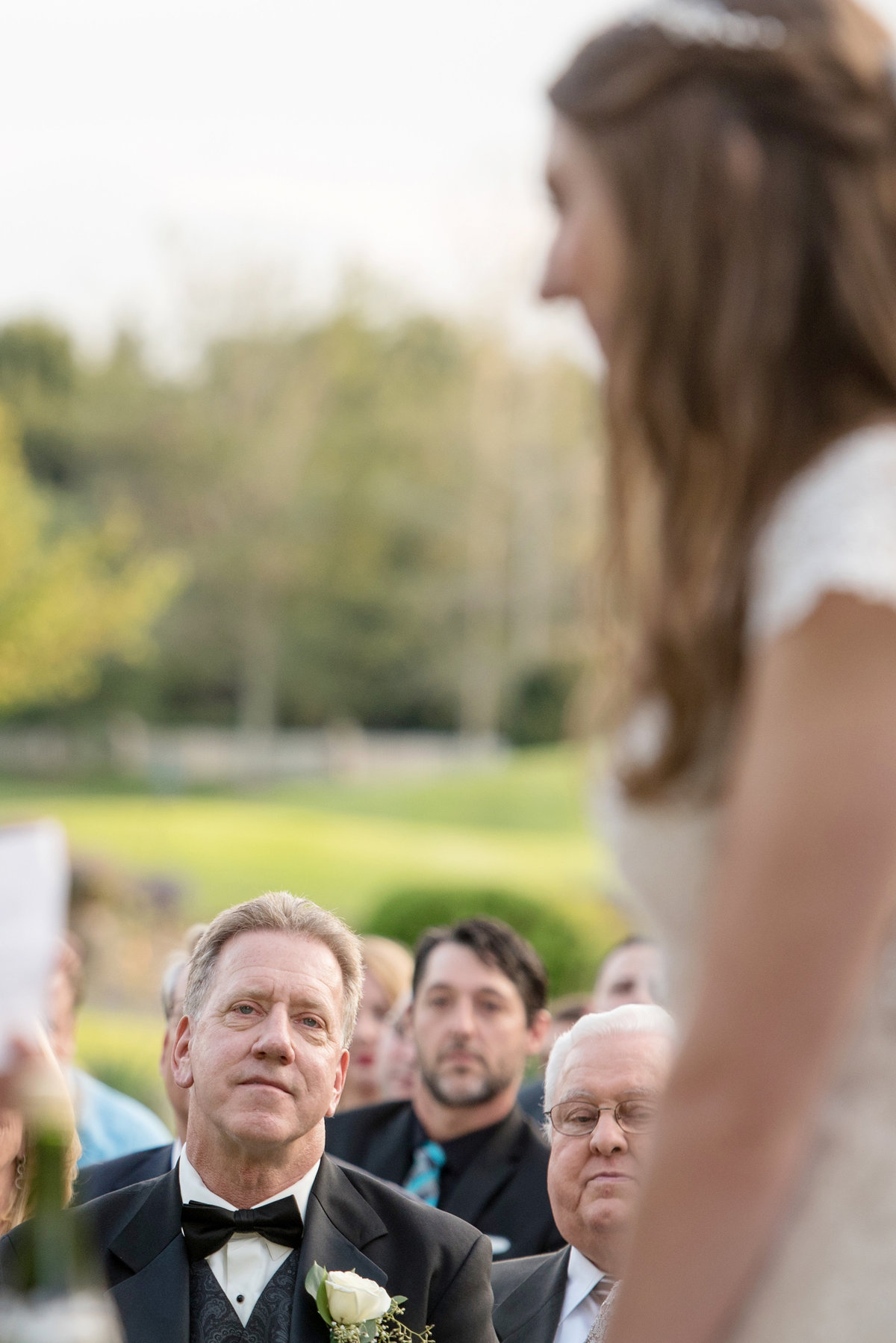 dad looking at bride during ceremony at Willow Creek Golf and Country Club