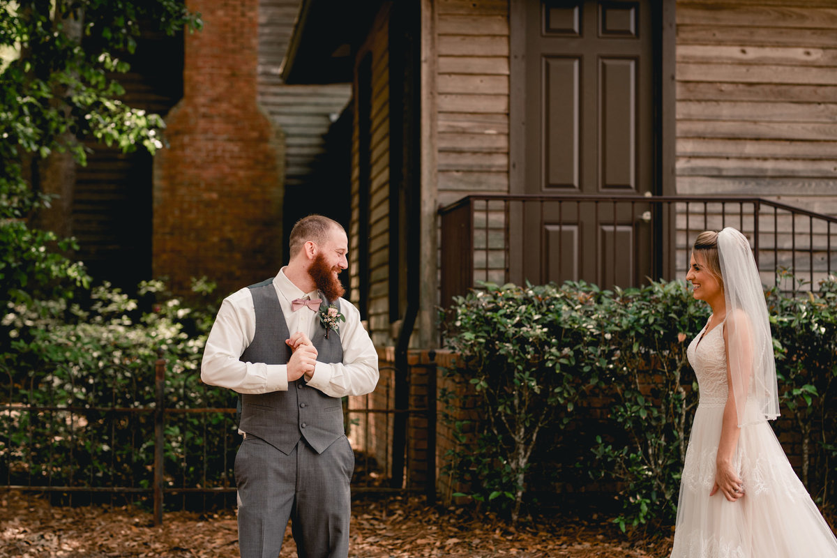 Groom sees his bride for the first look and cries, taken by Tallahassee wedding photographer.