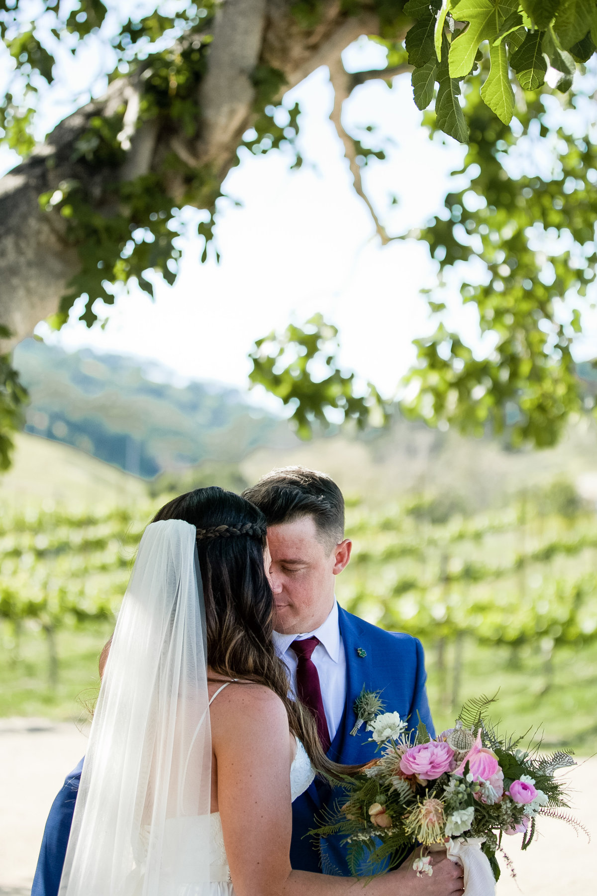 Romantic Spring Elopement  bride and groom in vineyard with Spring bouquet at Higuera Ranch  in San Luis Obispo  by Amy Britton Photography Photographer in St. Louis