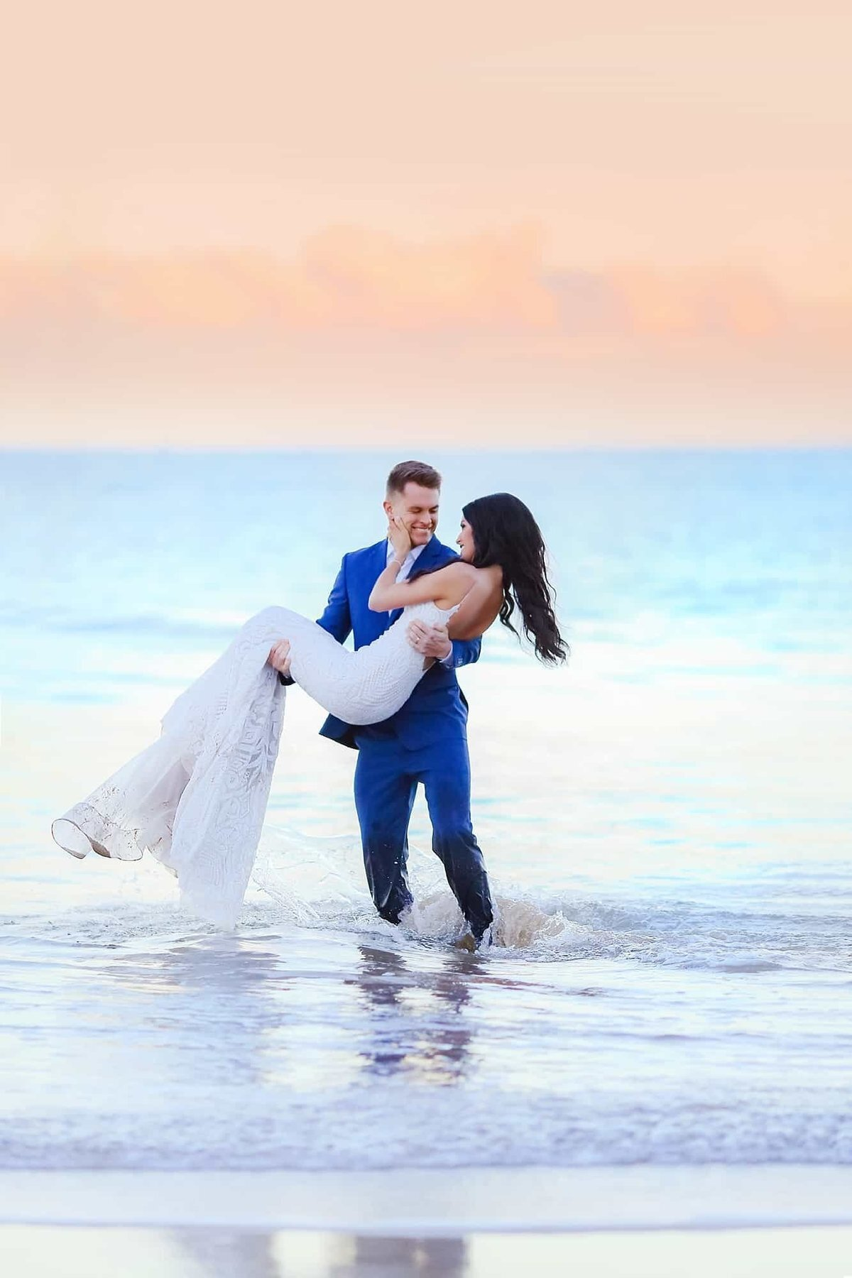 Candid portraits of bride and groom after their Maui sunrise elopement