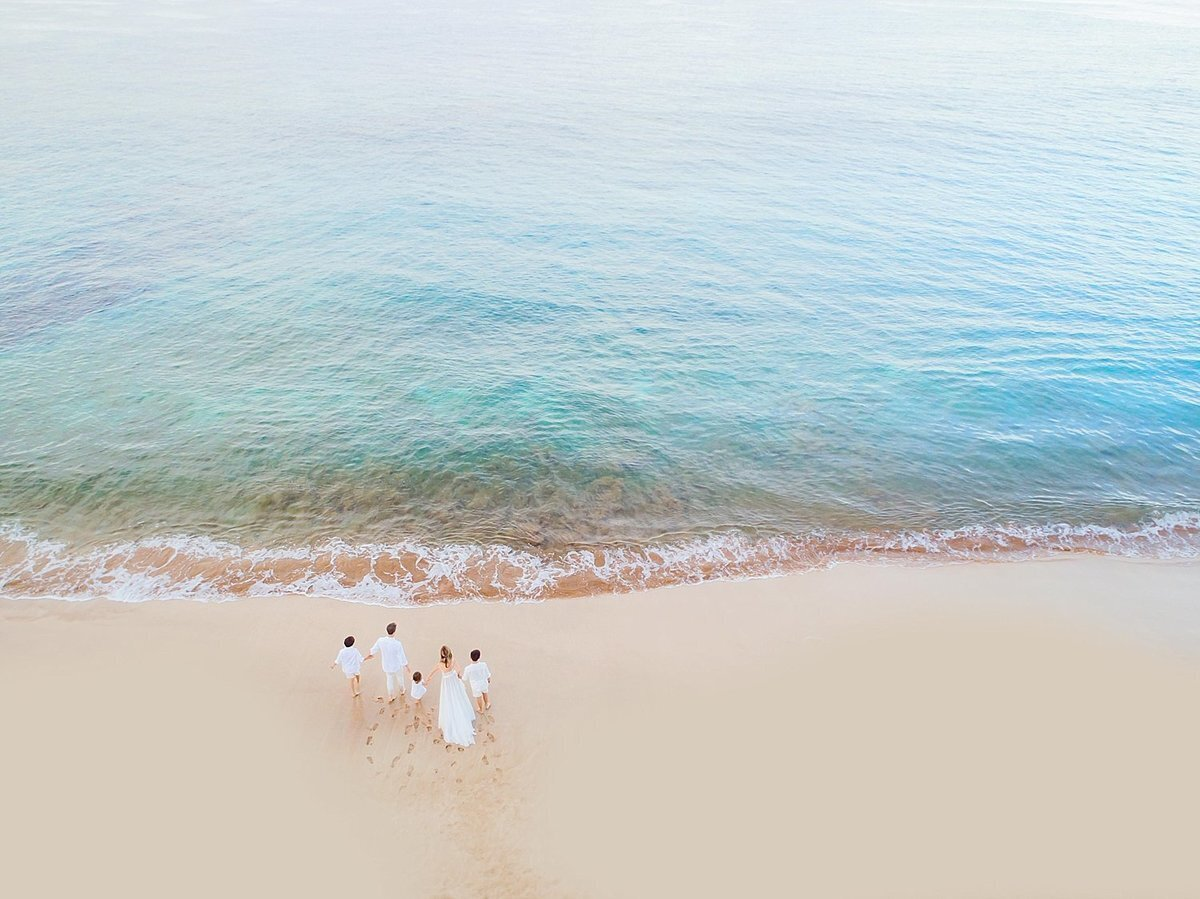 Maui drone photography session featuring a family of five walking on the beach