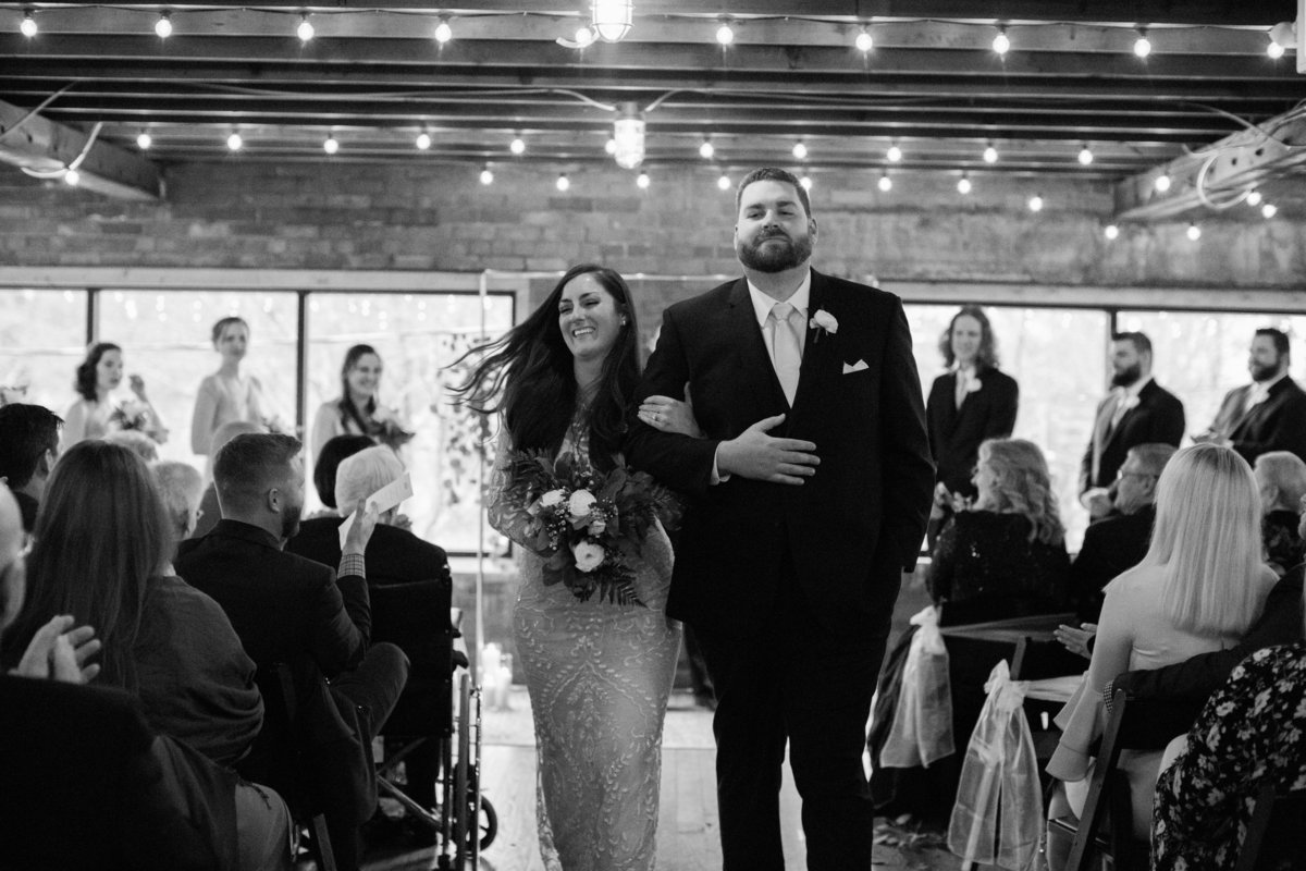 Wedding Photographer, black and white of couple walking down the aisle