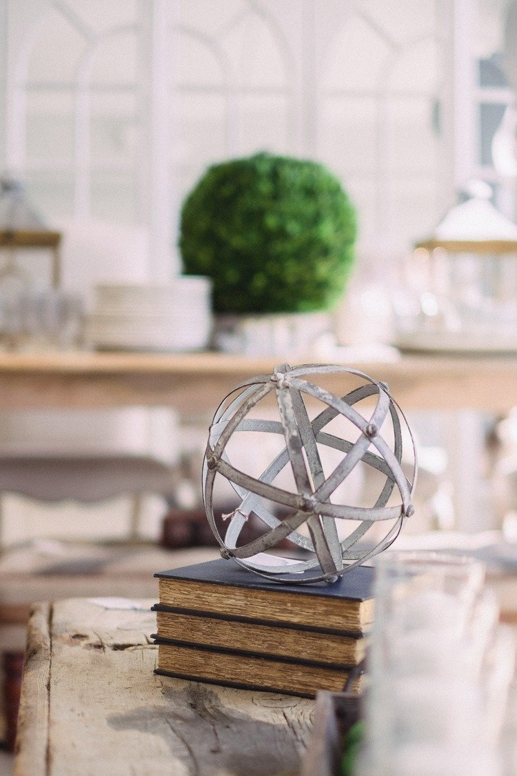 metal sphere on vintage books