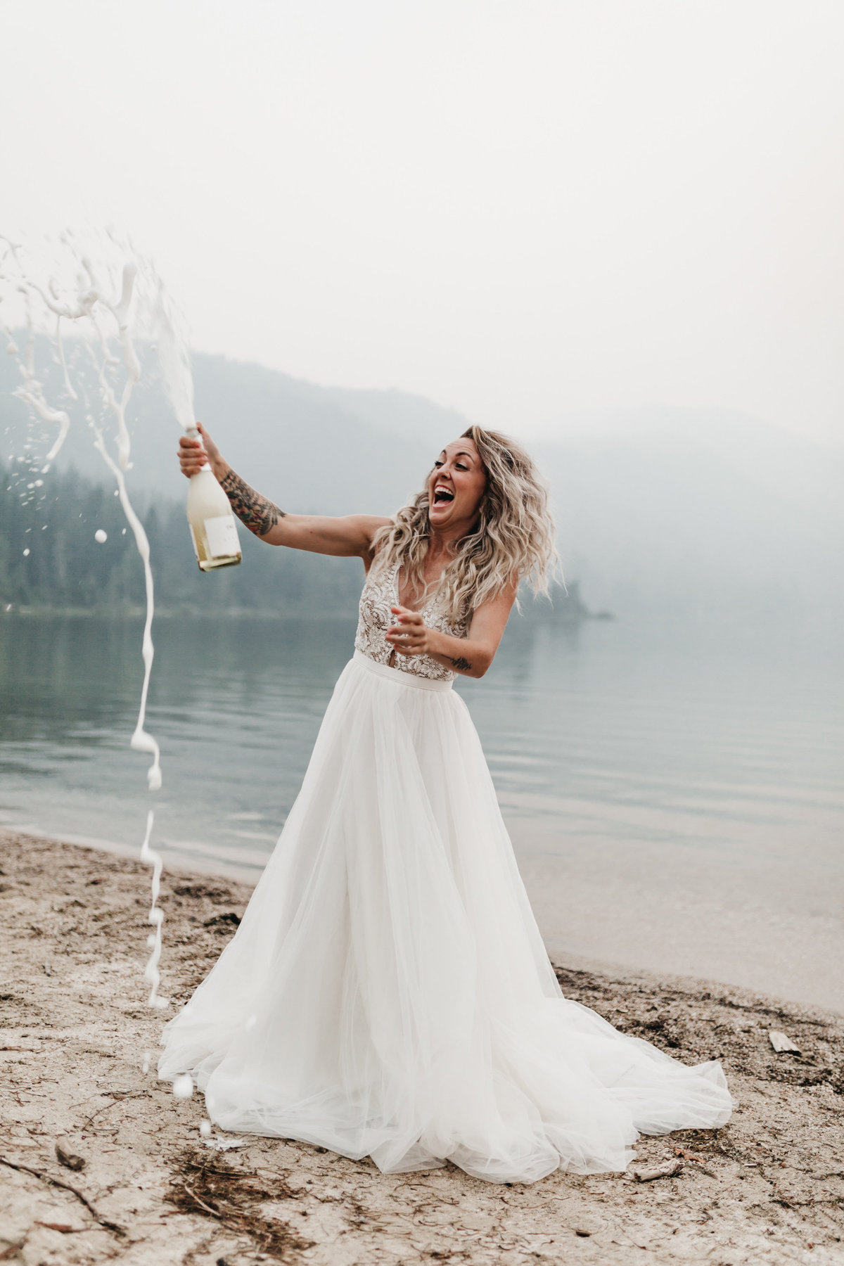 athena-and-camron-sara-truvelle-bridal-wenatchee-elopement-intimate-27-champagne-pop-bride