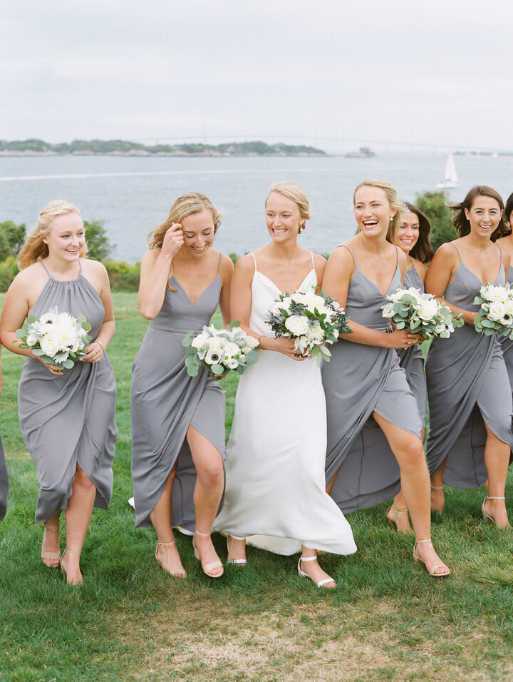 wedding bridal party walking from the ocean at newport castle hill