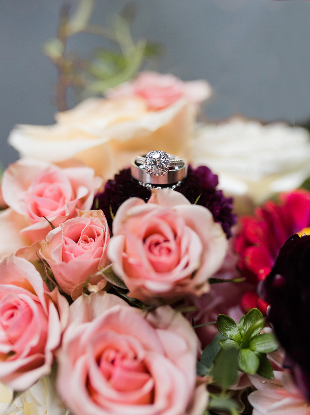 Wedding rings on floral bouquet