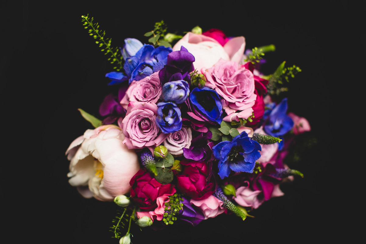 wedding bouquet with roses peonies and pansies - pinks lilac and purple