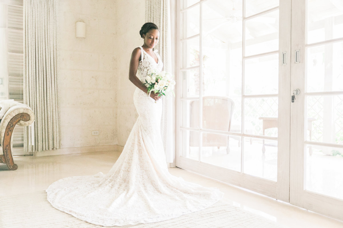 Portrait of bride in bridal suite  at Barbados destination wedding