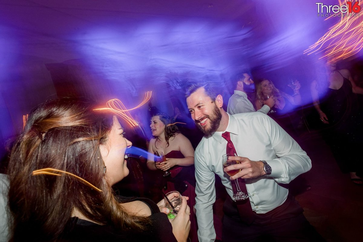 Guests dance at a wedding reception