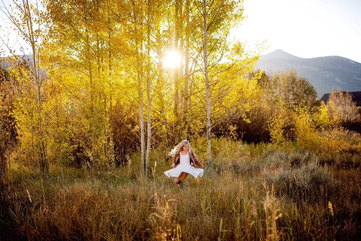 Little girl dancing in the sunset in Breckenridge