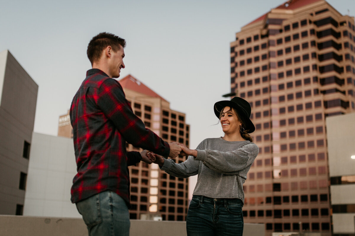 couple spinning on downtown rooftop