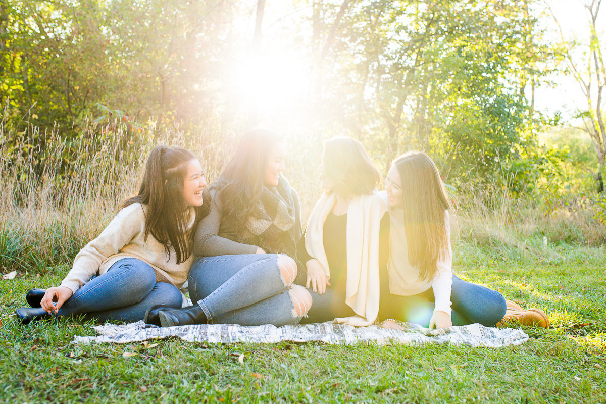 mother with three daughters laughing with sunshine streaming in {Milton Family Photographer}