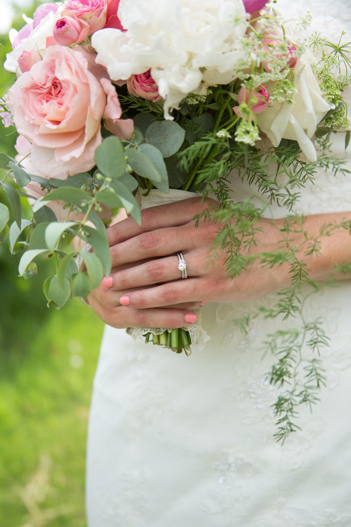 detail photo of bride's ring and bouquet at vintage inspired wedding