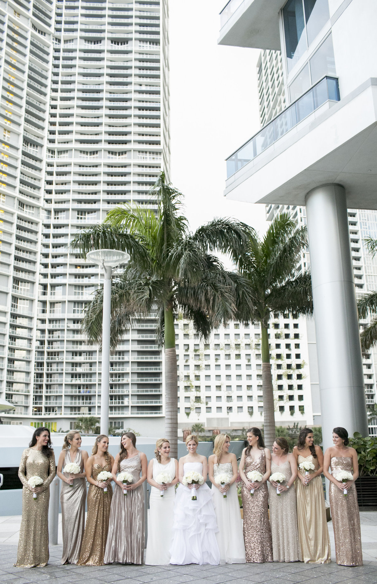 epic hotel wedding party in gold dresses