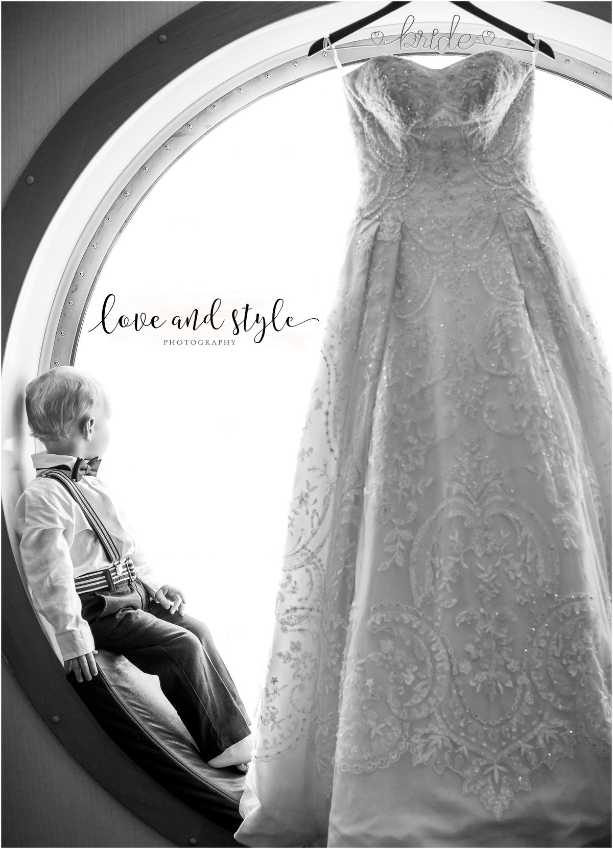Disney Dream Cruise Wedding Photo of the bride's ballgown hanging in the porthole with toddler son looking out the windo