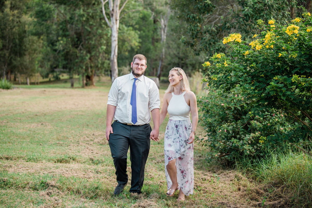 couple-walking-hand-in-hand-in-field-lead-images-ipswich (1 of 1)