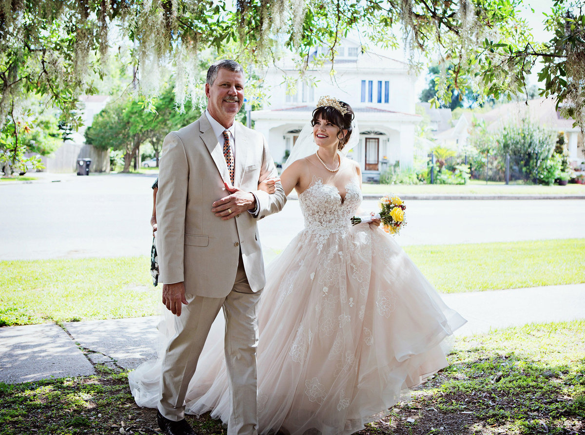 City Park bride smiles at her Dad as he walks her down the aisle