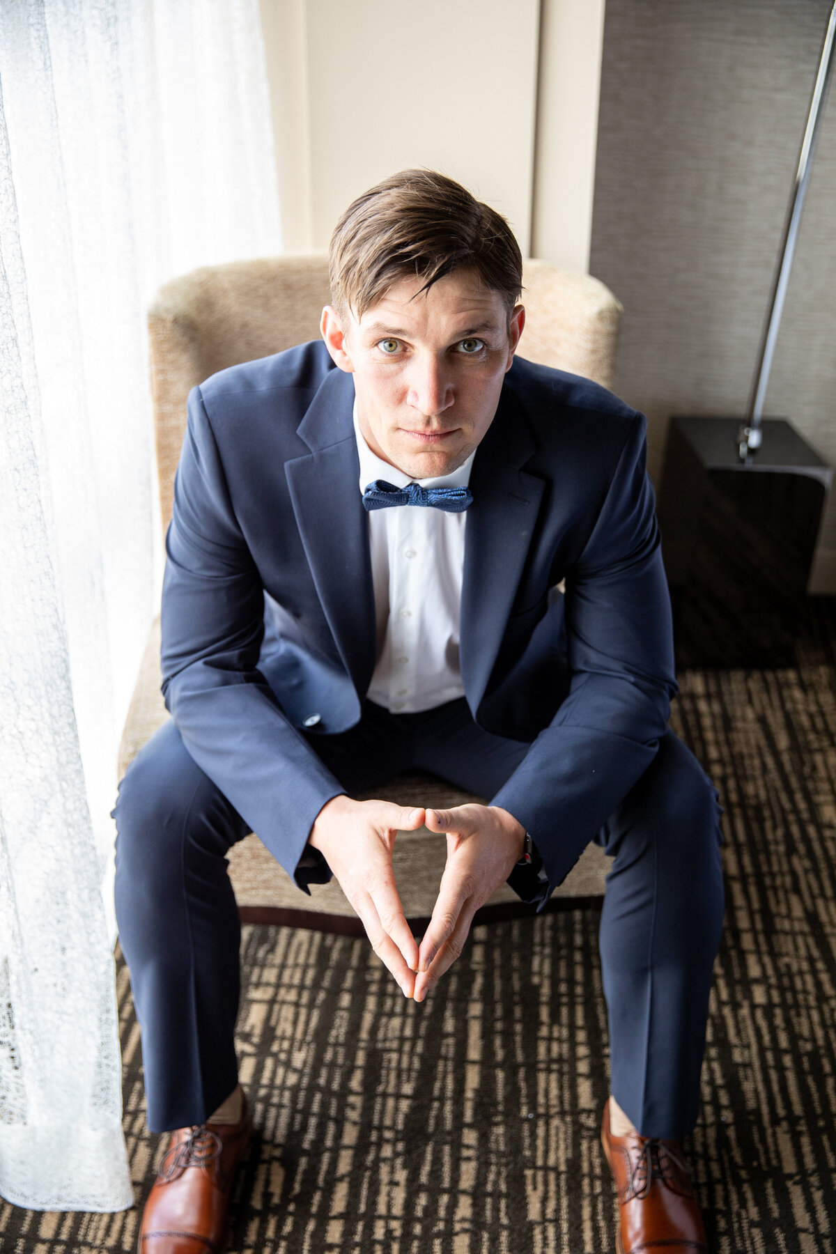 Groom Posing for a Serious Portrait