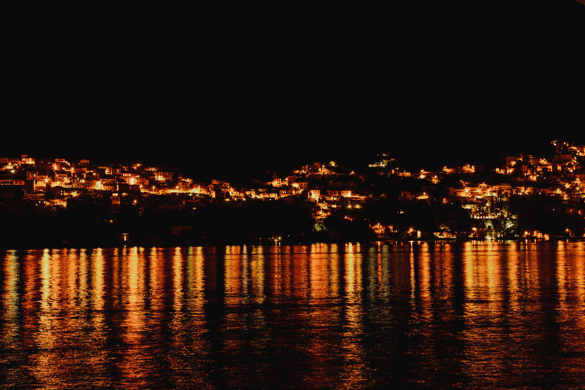 lake como village lights at night reflection