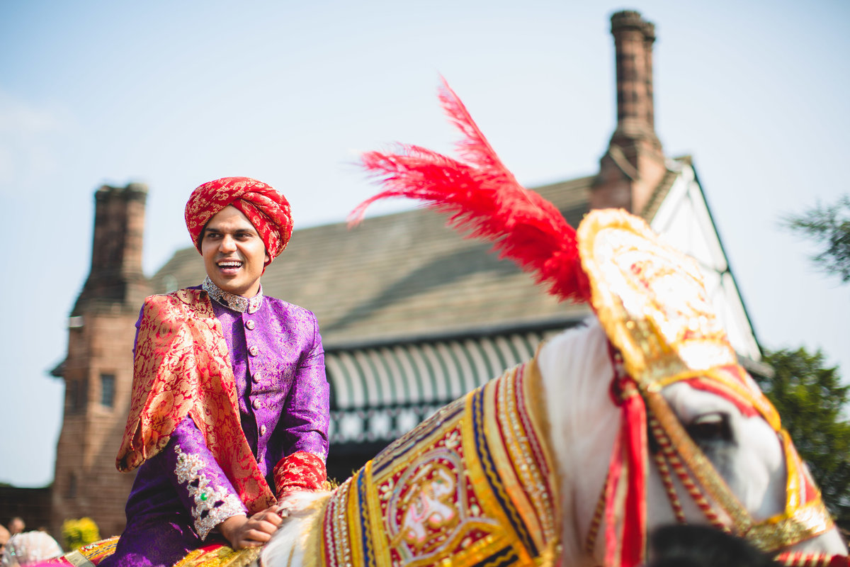 groom on white horse
