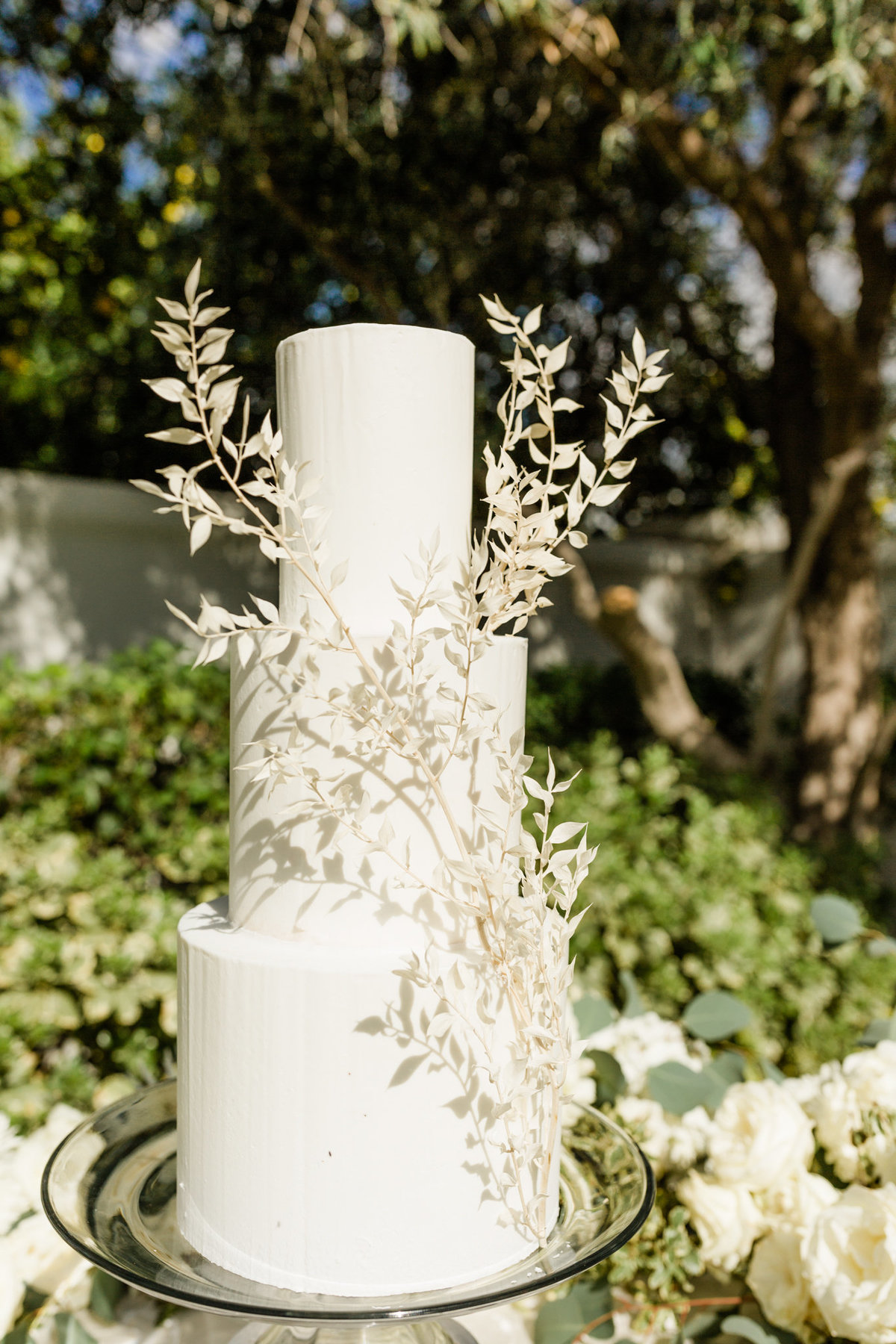 elegant white three tier wedding cake