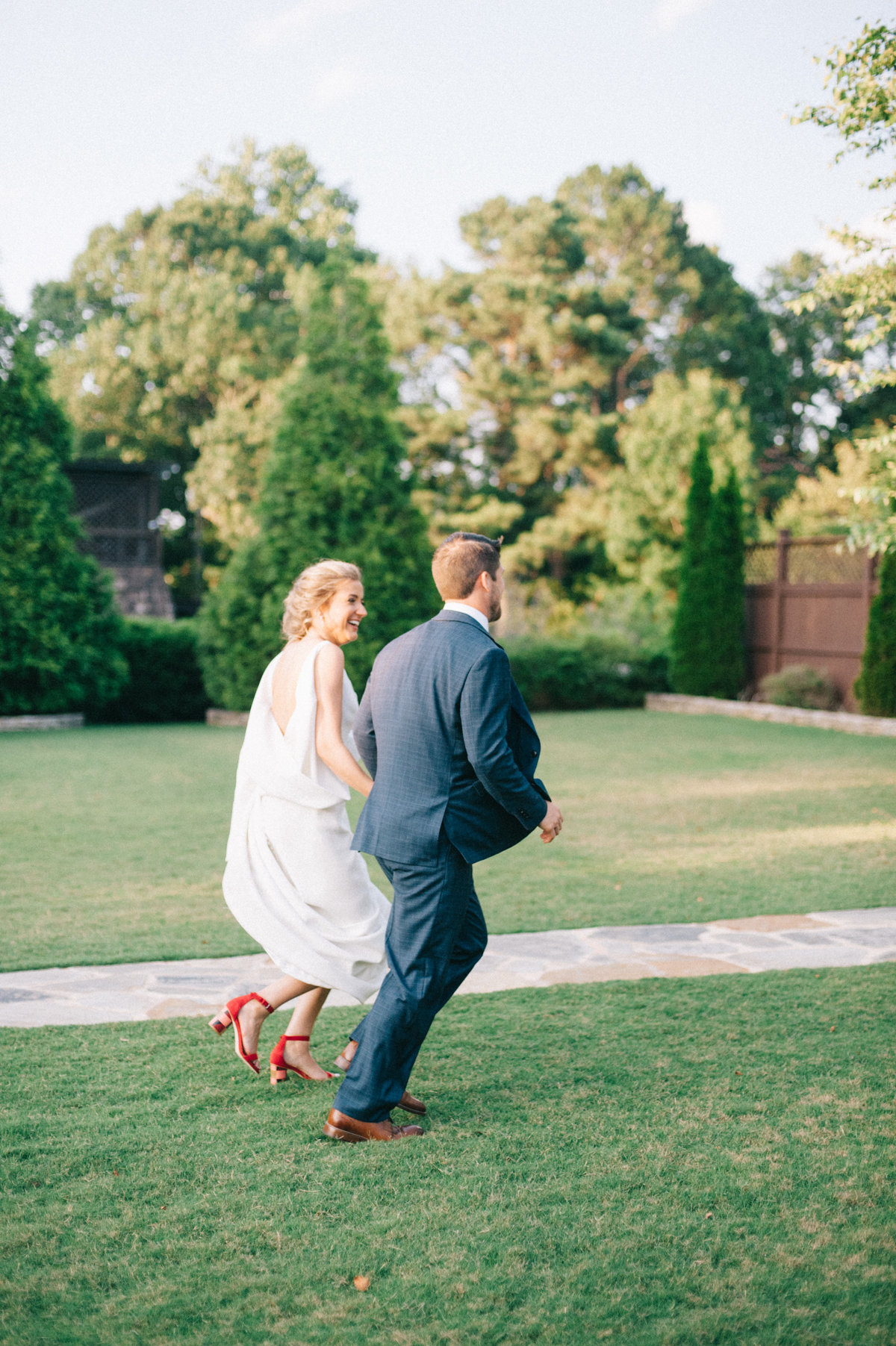 Cute running photo of couple after their wedding in Park Crest Hoover Alabama