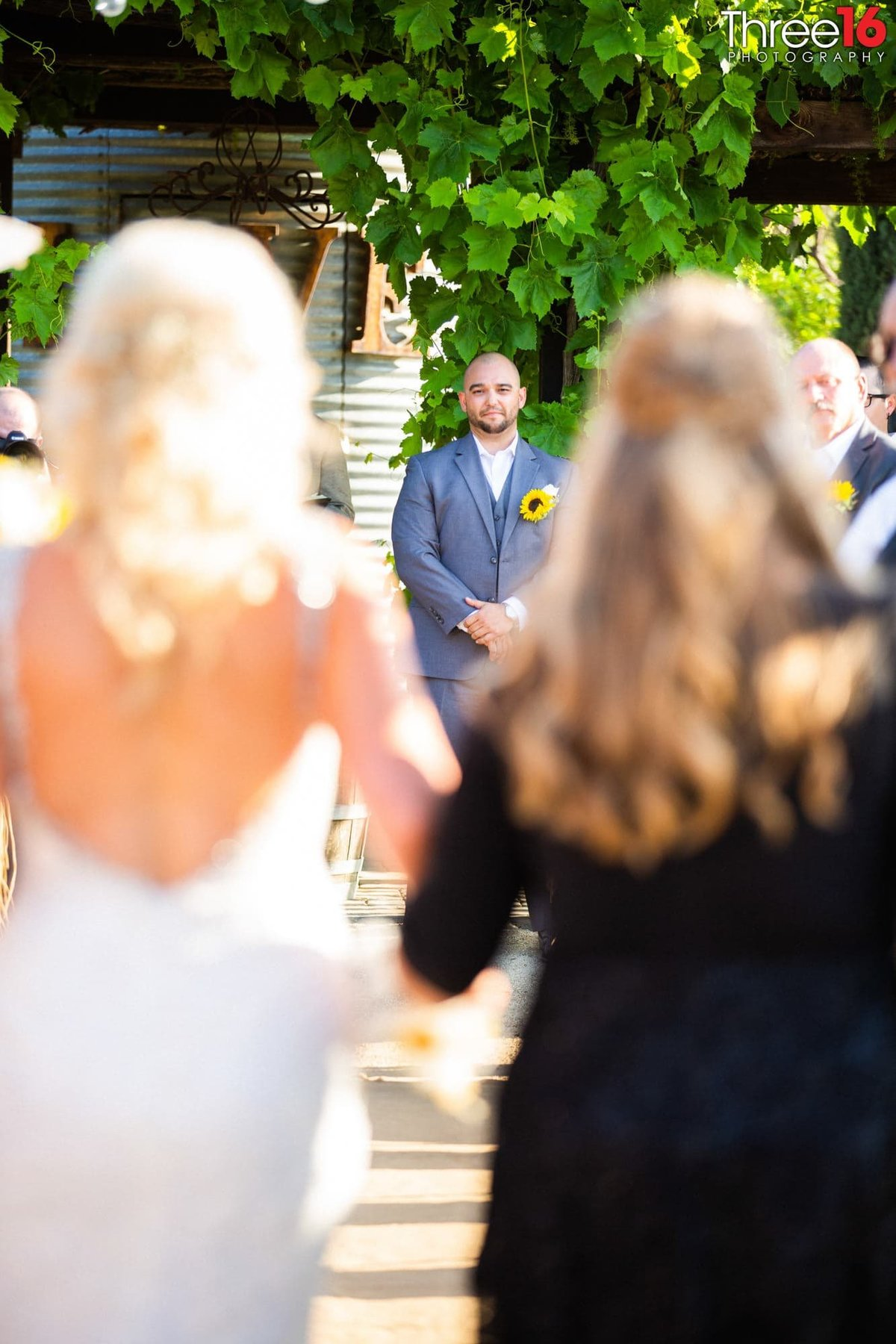Groom standing at the altar as Bride enters