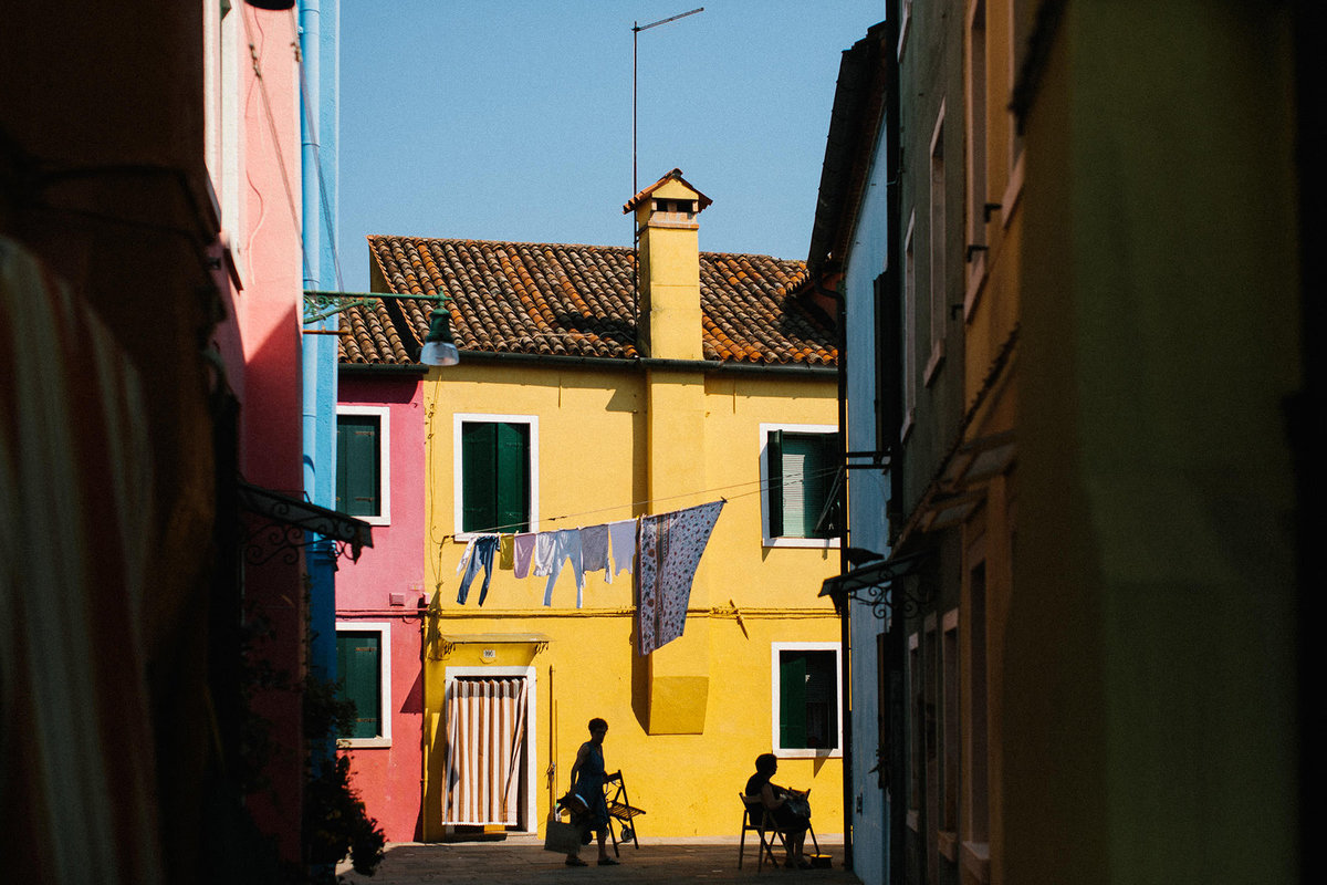 yellow painted building Burano Italy