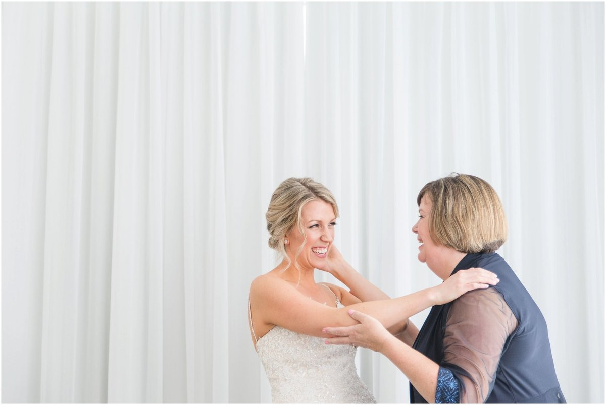 Bride and mother laughing
