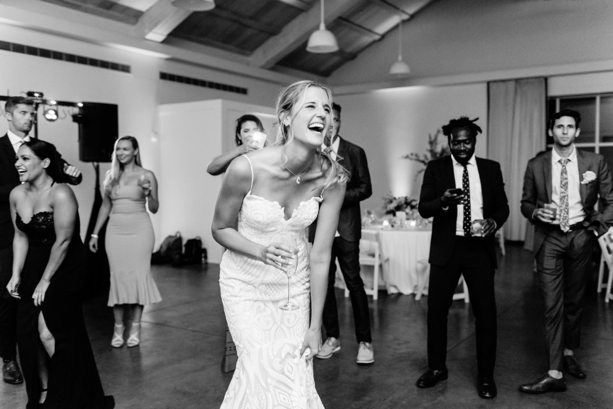 Bride laughing and dancing.