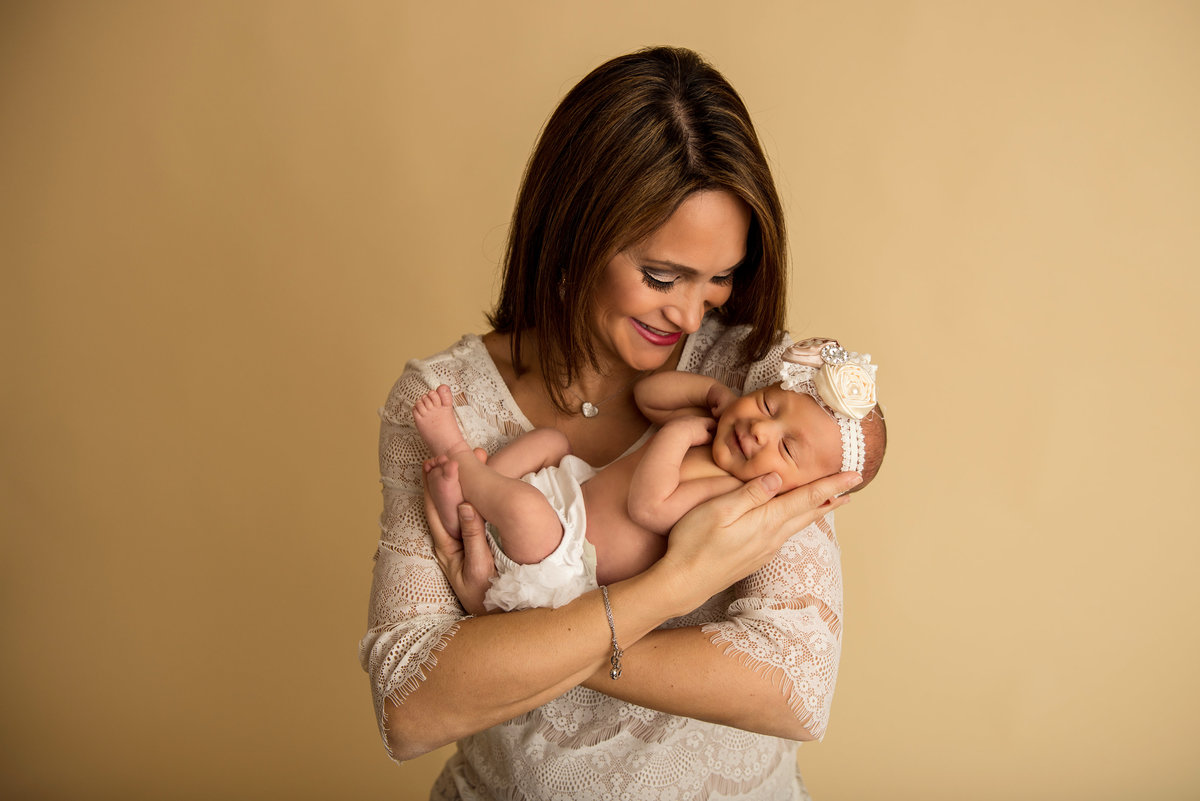 A mother soaks in her precious daughter during her baby portraits