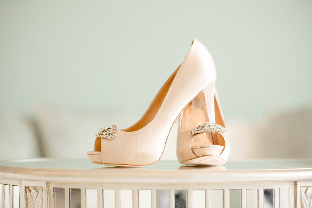Blush colored wedding shoes glimmer in the morning sun at villa de amore by matty fran photography