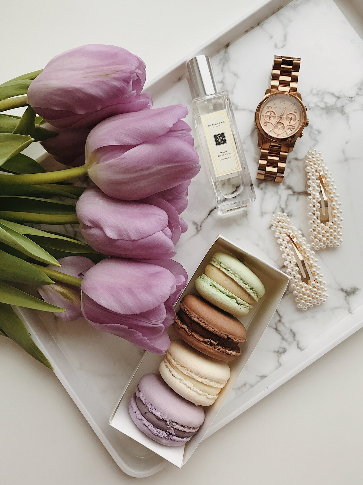 flat-lay-shot-of-macaroons-and-flowers-3890711