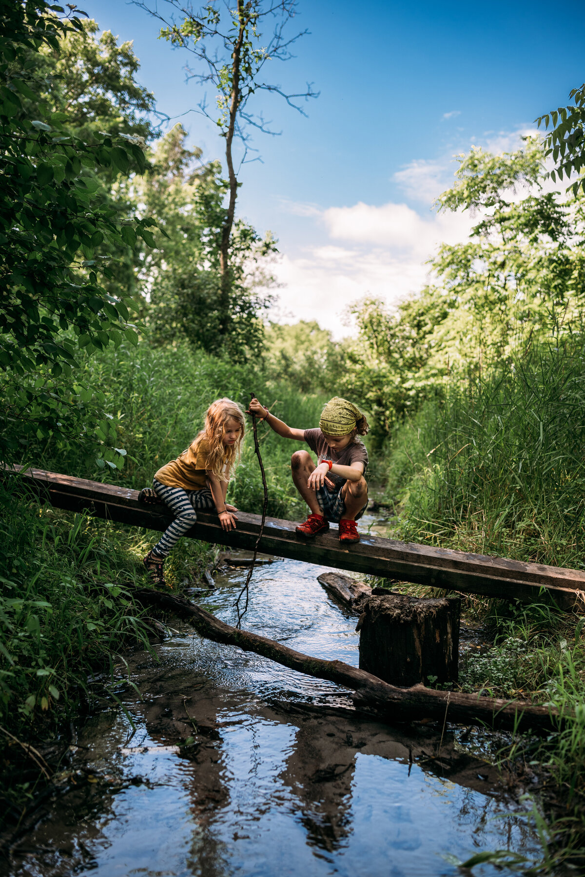 Children playing in creek Madison WI McKenna Patterson Photography